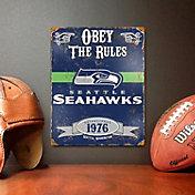 Party Animal Seattle Seahawks Embossed Metal Sign