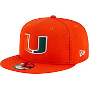 New Era Men's Miami Hurricanes Green Sideline Road 9Fifty Adjustable Snapback Hat