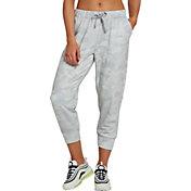 3f86786b467feb Product Image · Nike Women's Dri-FIT Rebel Fleece 7/8 Training Pants