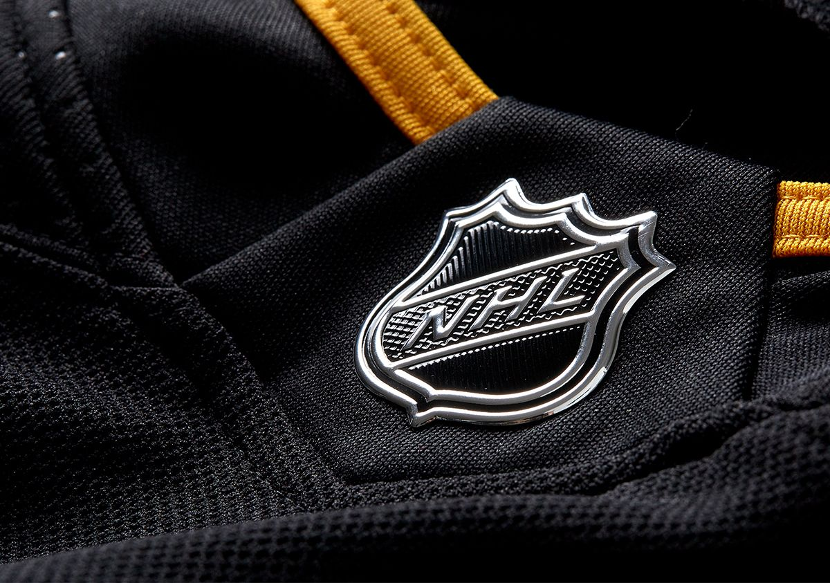 A closeup of the NHL logo on a jersey..