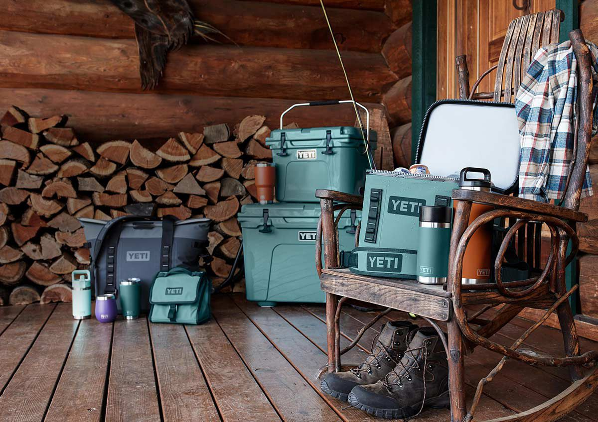 A collection of YETI products featuring the Hopper M30, Daytrip Lunch Bag, Rambler Jr. 12 ounce Bottle, Rambler 20 with Magslider, Rambler 10 ounce Wine Tumbler, Tundra Haul Cooler, Roadie 20, Rambler 30, Hopper Flip 12, Rambler 12 ounce Hotshot Bottle, and Rambler 36.