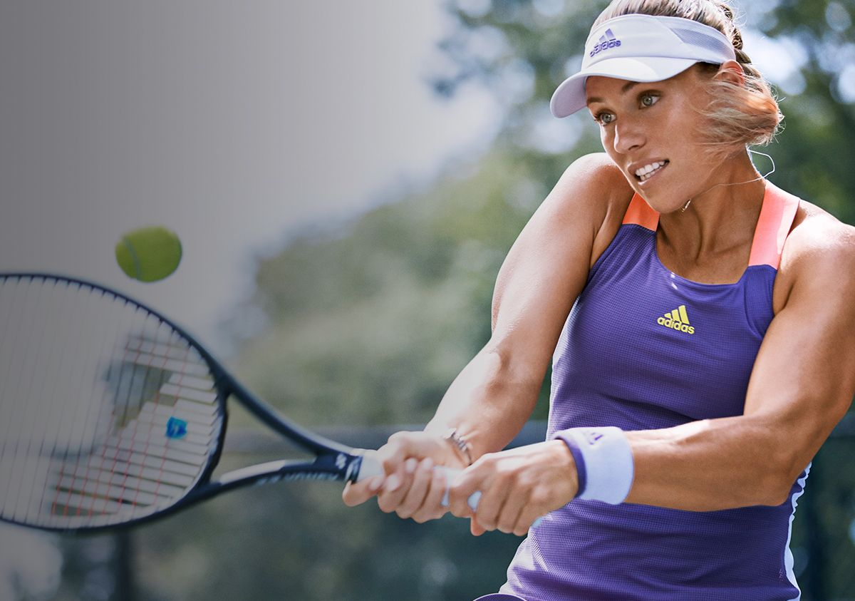 Female Tennis Player Wearing Adidas Tennis Apparel And Swinging Racquet