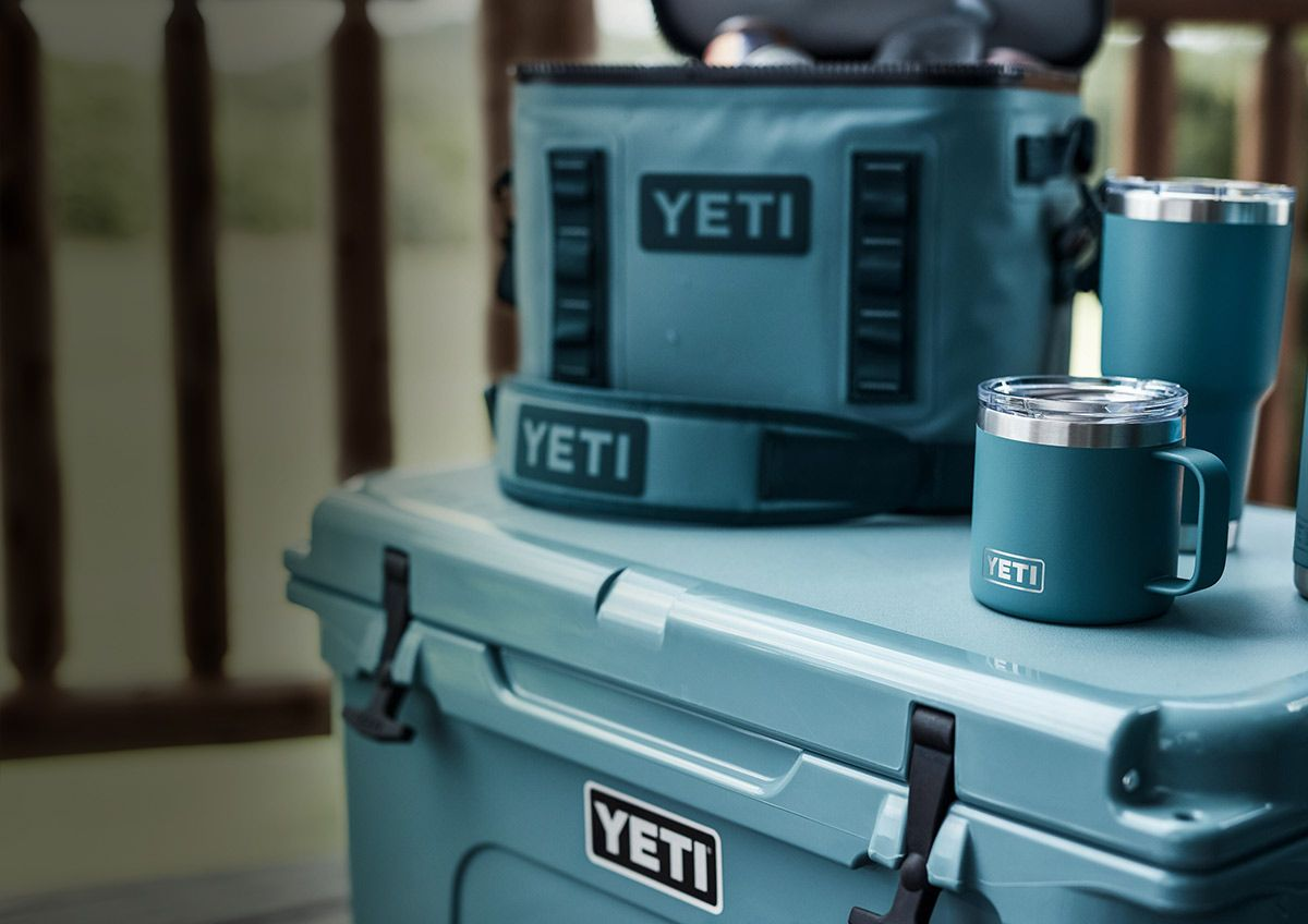 A Yeti Hopper M30, Yeti Rambler 12oz Hotshot Bottle, and Yeti Rambler Lowball in the new River Green color.
