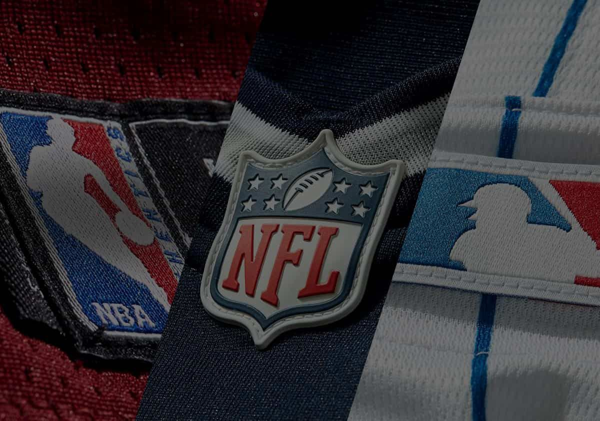 A collection of logos from the NFL, NBA and MLB as they appear on officially licensed apparel.