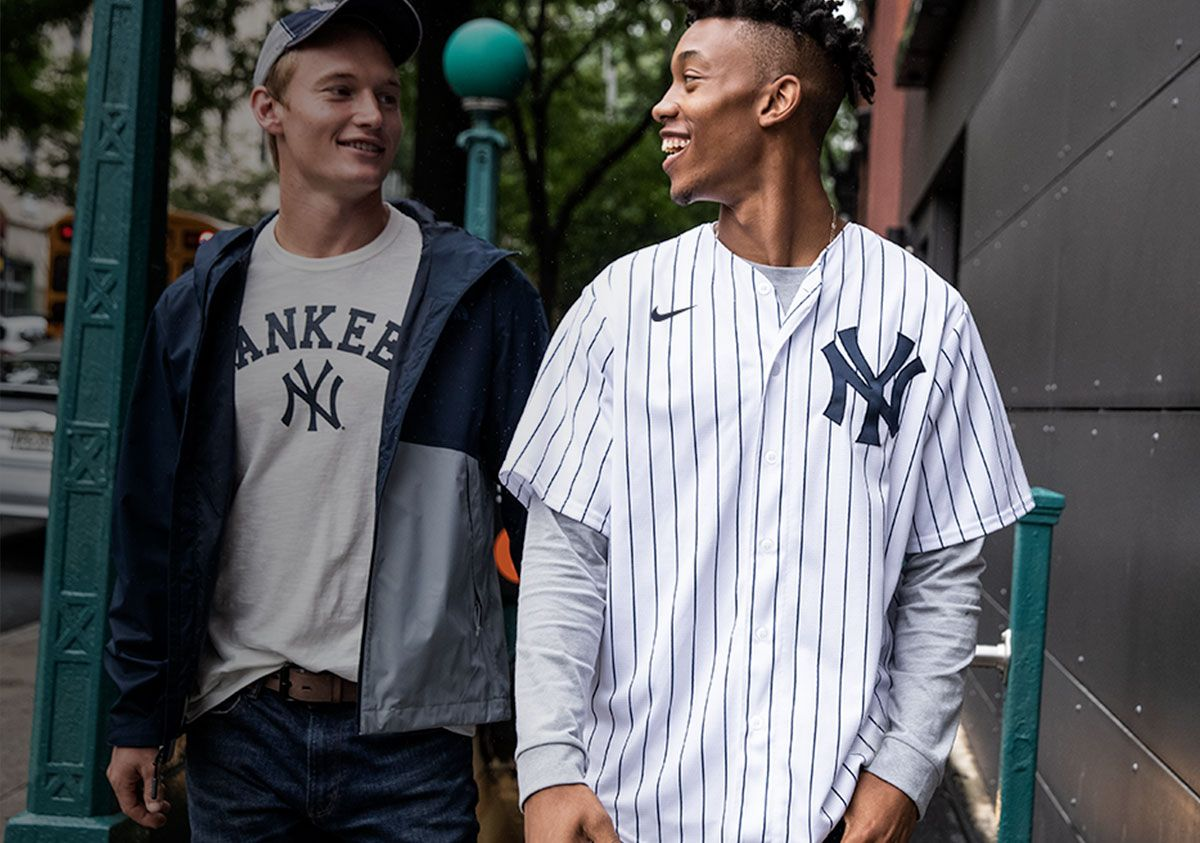 Two fans walking down the street wearing new nike apparel.