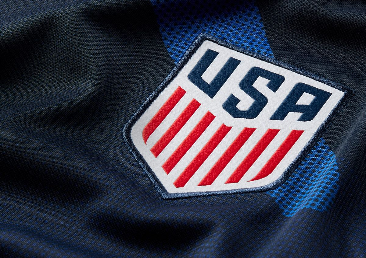 A closeup of the U.S. Men's National Team logo on the front of the jersey.