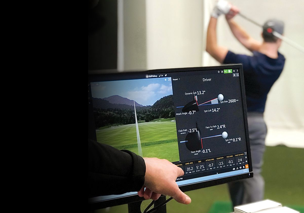 Male Golfer Having Swing Analyzed By Golf Professional At Golf Galaxy