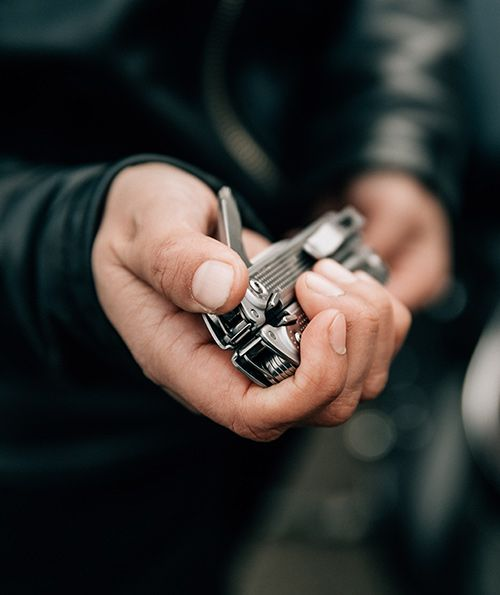 Man wearing black leather jacket hold the new leatherman free multipurpose tool in his right hand