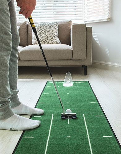 Golfer Practicing Put At Home