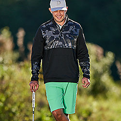 Golfer in PUMA Quarter-Zip and Green Golf Shorts