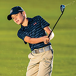 Youth Golfer Wearing Under Armour Apparel
